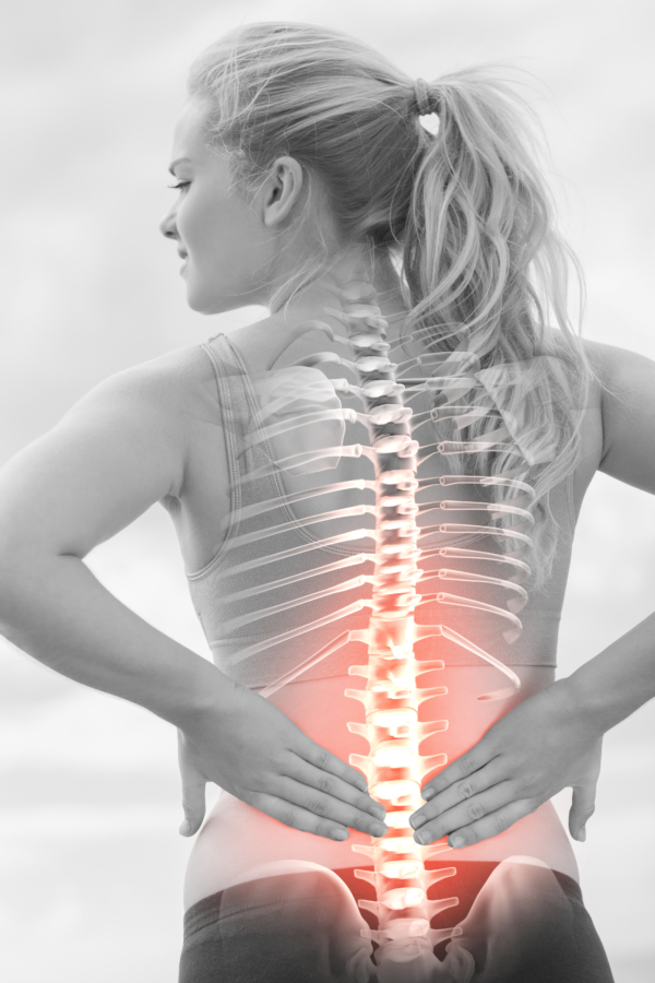 Woman holding sine with back pain.